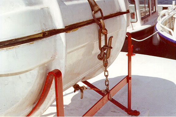 Photo 13 - Manual release Senhouse slip securing inflatable liferaft in cradle on superstructure top