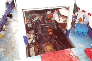 Photo 4 - Opening in main deck with no steel coaming in way of portable plywood panels of engine casing